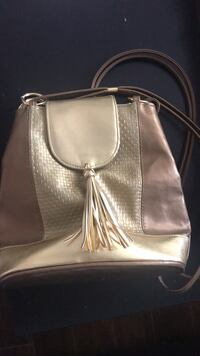Gold crossbody bag with tassels