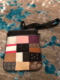 black, white, and red leather crossbody bag Alexandria, 22315