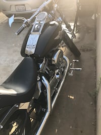 Black and gray touring motorcycle Commerce, 90040
