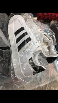 white-and-black Adidas Superstar shoes
