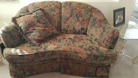 brown orange and green floral cuddle sofa