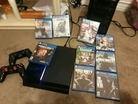 Sony PS4 console with controller and game cases Victorville, 92392