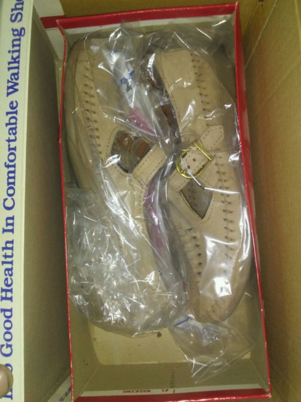 pair of women's beige flats with box