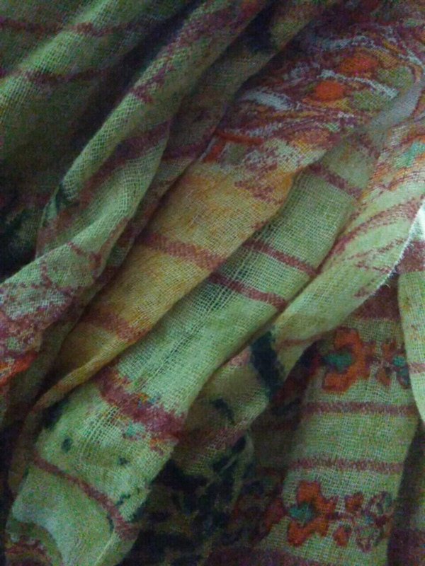 green, red, and yellow textile