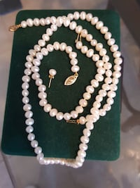 Pearl necklace , bracelet, and earrings