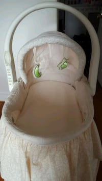 Cream accented with green hardly used bassinet Walkersville, 21793