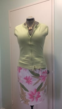 Size medium/ large green zip-up jacket and pink, green, and white floral mini skirt