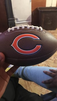 brown and orange football Chicago, 60612