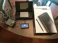 Nintendo DS Lite with game and power plug.   STONEYCREEK