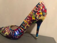 blue, red, and yellow floral stiletto 553 km