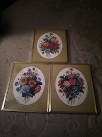 Three picture frames with floral photos