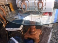 Large glass top table and chairs