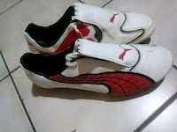 pair of white-and-red Nike sneakers Springfield