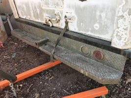 Big heavy truck bumper with hitch.