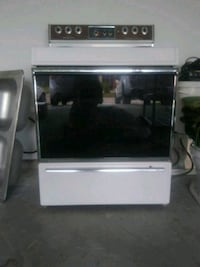gray and black induction range oven. Good conditio Davenport, 33837