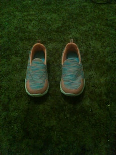 pair of blue and peach slip-on shoe