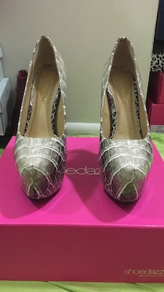 pair of grey snake skin leather heeled shoes with box