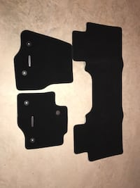 Ford factory carpeted floor mats. Never used. Fits  11-17 250 and 350 crew cabs. Hedgesville