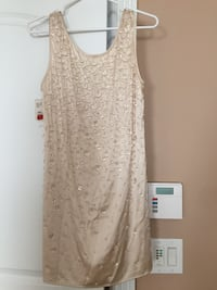 Beautiful champagne color silk & beaded cocktail dress brand new with tags silk on it. Size medium Indianapolis, 46220