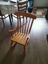 brown wooden windsor rocking chair Innisfil, L9S 1V4