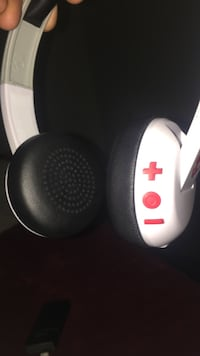 white and black cordless headphones