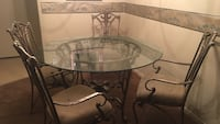 round glass top table with gray metal base Brownsville, 78521