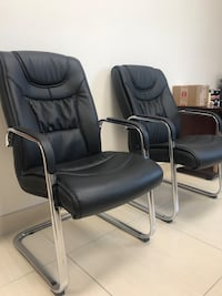 Each 80$6 black leather padded armchairs  Laval, H7G 0J7