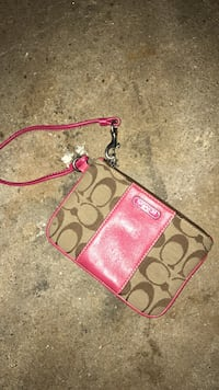 red and brown Coach monogram print wristlet