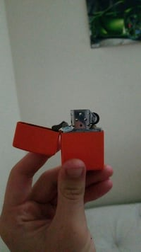 red and silver flip lighter 35 km