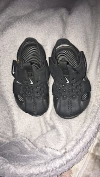 pair of black leather sandals Decatur, 30034