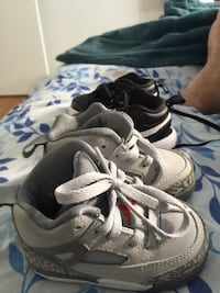 Pair of gray-and-black nike basketball shoes New York, 11207