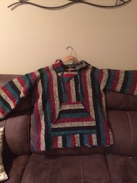 Red, black, and green striped sweater 547 km