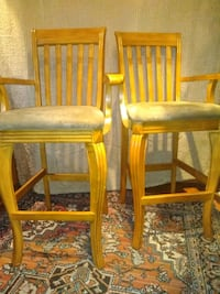 two brown wooden framed brown leather padded chairs Columbus, 31903