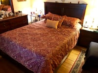brown wooden bed frame with brown bed sheet Los Angeles, 91303
