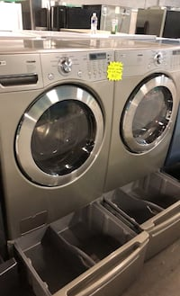 LG front load washer And dryer set with pedestals Baltimore, 21223