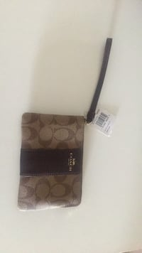 Brown and black coach wristlet New York, 11377