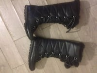 pair of quilted black leather knee-high duck boots Toronto, M8V 1C5