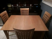 rectangular brown wooden table with six chairs dining set Calgary, T3C 0N7
