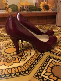 Size 7 w red heels nickels brand worn only 2x  Gerry, 14740