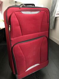 Red and black soft-side carry-on luggage New York, 10034