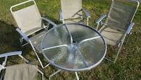 GUC Metal framed glass top patio table set  Saanichton, V8M 1X7