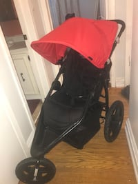 Baby's red and black stroller St Catharines, L2P 2A4