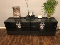 Black wooden tv stand.  Humble, 77396