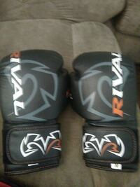 black, gray, and white Rival punching gloves