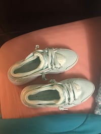 pair of white-and-blue Nike running shoes Bay Saint Louis, 39520