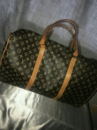 brown and black Louis Vuitton leather tote bag Aurora, 80012