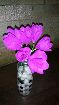 purple flowers in clear bottle
