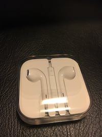 White apple earpods in case Vancouver, V5Z 1G1