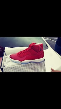 Unpaired red air jordan 11 shoe with box