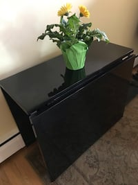 Black lacquer console that converts to a table